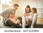 happy family with two daughters ... | Shutterstock . vector #647123584