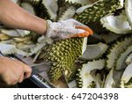 a man with knife is peeling the ... | Shutterstock . vector #647204398