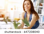 young pretty woman smiling at... | Shutterstock . vector #647208040