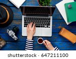 work table view with a laptop... | Shutterstock . vector #647211100