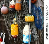 lobster buoys on display near a ... | Shutterstock . vector #647236714