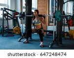 workout  a woman in the gym.... | Shutterstock . vector #647248474