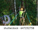 boy climbs in a high wire park... | Shutterstock . vector #647252758