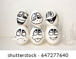 eggs with painted faces. photo... | Shutterstock . vector #647277640