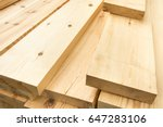 Piled lumber near a lumber mill ...