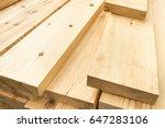 Piled lumber near a lumber mill ...
