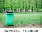 green urn for garbage in the... | Shutterstock . vector #647288308