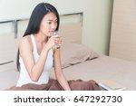 beautiful young woman sitting... | Shutterstock . vector #647292730