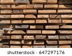 pile of new wooden boards on a... | Shutterstock . vector #647297176