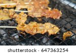 barbecue pork on grills | Shutterstock . vector #647363254