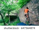 the climber climbs the stone.... | Shutterstock . vector #647364874