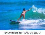 beach girls. riding the waves.... | Shutterstock . vector #647391070