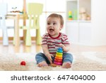 baby child playing with... | Shutterstock . vector #647404000