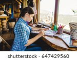 beautiful young painter in her... | Shutterstock . vector #647429560