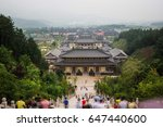 Small photo of Jiangxi: China-July 27, 2014:believers pray in Donglin Buddha before kneel kowtow. Donglin Buddha is the world's first high Amitabha like. Located in the famous Mount Lu in china.