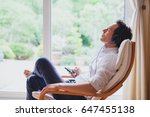 listening relaxing music at... | Shutterstock . vector #647455138