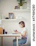 caucasian freelancer drinking... | Shutterstock . vector #647484280