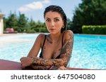 intense tattooed woman close up ... | Shutterstock . vector #647504080