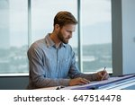 young male architect working in ... | Shutterstock . vector #647514478