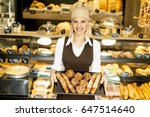 beautiful female bakery posing... | Shutterstock . vector #647514640