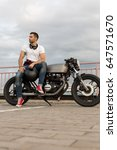 handsome rider guy with a beard ... | Shutterstock . vector #647571670