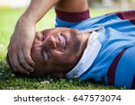 injured rugby player with eyes... | Shutterstock . vector #647573074