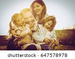 happy family playing outdoor.... | Shutterstock . vector #647578978
