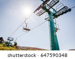 ski lift with blue sky and sun... | Shutterstock . vector #647590348