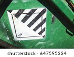 Warning sign on green cargo...