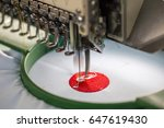 Small photo of Embroidery machine needle in Textile Industry at Garment Manufacturers, Embroidery needle, Needle with thread (selective focus and soft focus)