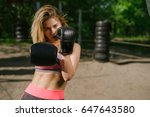 confident girl training boxe ... | Shutterstock . vector #647643580