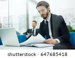 serious economist looking... | Shutterstock . vector #647685418