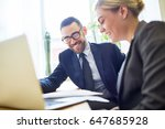 two professionals discussing... | Shutterstock . vector #647685928
