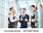 friendly colleagues with drinks ... | Shutterstock . vector #647687806