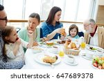 Small photo of Big family of three generations having breakfast in restaurant
