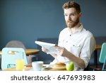 portrait of handsome bearded... | Shutterstock . vector #647693983