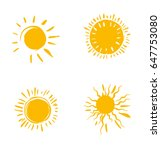 four hand drawn sun symbols.