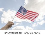 hand holding american flag... | Shutterstock . vector #647787643