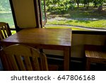 wooden table and chairs put... | Shutterstock . vector #647806168