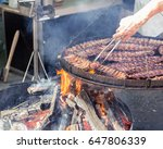 cooking meat on the big flaming ... | Shutterstock . vector #647806339