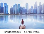 man standing on the pier... | Shutterstock . vector #647817958