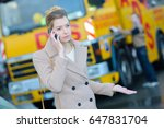 sullen woman on the phone | Shutterstock . vector #647831704