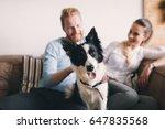 beautiful couple relaxing at... | Shutterstock . vector #647835568