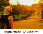 blonde girl walk sunny path | Shutterstock . vector #647855794