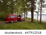 red car with tiny camper... | Shutterstock . vector #647912518