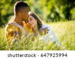 young couple hugging outdoor in ... | Shutterstock . vector #647925994