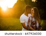 multi ethnic couple hugging  ... | Shutterstock . vector #647926030