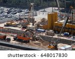 construction work continues on... | Shutterstock . vector #648017830