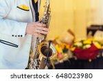 saxophonist in white jacket... | Shutterstock . vector #648023980