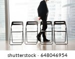 man in business suit passing by ... | Shutterstock . vector #648046954